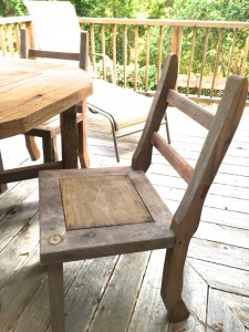 Outside chairs, aged redwood with old fence posts for front legs
